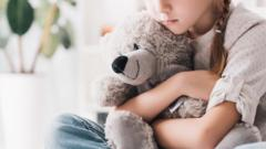 girl-holding-teddy-bear.