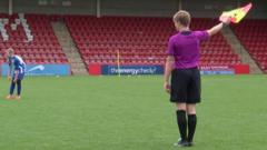 Young referee in a purple shirt