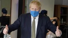 Boris Johnson wearing a mask on a visit in his Uxbridge constituency
