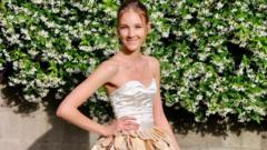 Jess Collins wearing ballgown made of mango seeds