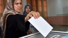 An Algerian woman casts her vote in parliamentary elections in 2017.
