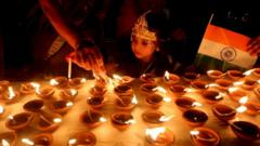 A small child looks at Diwali candles at a temple in Bhopal, India
