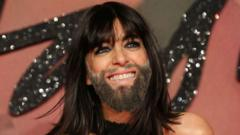 Female presenter with full beard.