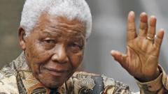 Nelson Mandela waving