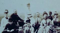 Family sat on the stones at stonehenge