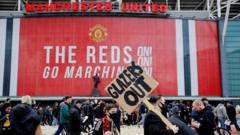 Manchester United fans protest against their owners before the Manchester United game