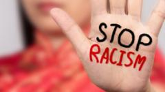 Stop Racism written on a hand