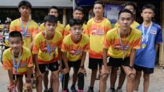 Members of the 'Wild Boars' football team and their coach