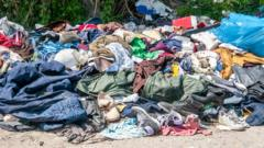 Discarded clothes on a rubbish pile.