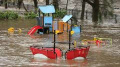 A playground is flooded as rivers burst their banks on in Hebden Bridge, England.