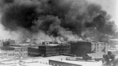 Smoke rises from buildings during the race riot in Tulsa, Oklahoma, U.S. in 1921