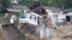 House falling into river