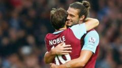 Andy Carroll and Mark Noble celebrate West Ham's win