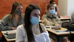 Students wearing face masks attend a class at the Padre Antonio Vieira high school in Lisbon, Portugal on April 19, 2021.