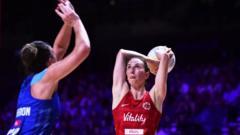 Rachel Dunn shooting a netball.