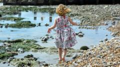 Little girl walking on a beach