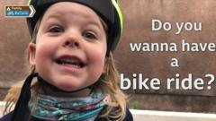Rhoda smiles at the camera with text saying 'Do you wanna have a bike ride?'