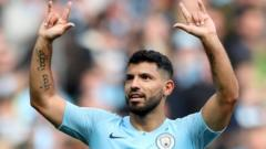 Sergio Aguero with his hands in the air