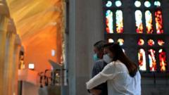 People embrace at the Sagrada Familia basilica in Barcelona, Spain, 4 July 2020