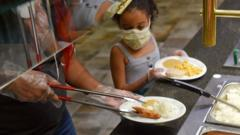a little girl is served at a buffet