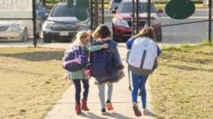 School children wearing facemasks walk outside Condit Elementary School in Bellaire, outside Houston, Texas