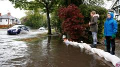 Residents sand bag their houses as flooding hits Newcastle-under-Lyme, Staffordshire