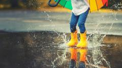 Child-in-wellies-jumping-in-a-puddle