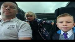 Kids pictured in car