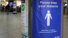 Tube station social distancing sign