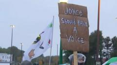 "Protest banner saying ""Joyce should have a voice"""