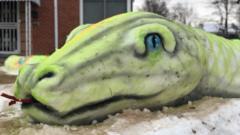 A snow sculpture of a snake