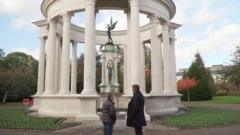 Dafydd and his dad looking at a cenotaph