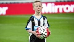 Tyler in on the pitch as a Newcastle United mascot