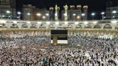 Muslim Hajj pilgrims praying around the holy Kaaba at the Grand Mosque in Mecca, Saudi Arabia