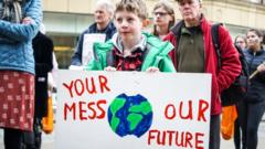 Boy-holds-up-a-banner-at-a-climate-change-protest.