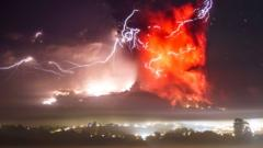 Lightning cracks through a high plume of fire above a volcano.