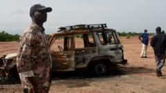 A Nigerien soldier stands guard in the Kouré Reserve, about 60 km from Niamey on August 21, 2020
