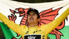 Geraint Thomas with the Welsh flag.
