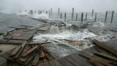 Portions of a boat dock and boardwalk are destroyed by powerful wind and waves as Hurricane Florence arrives September 13, 2018 in Atlantic Beach, United States.