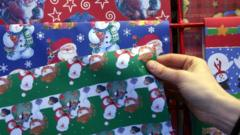 Christmas shopper buys wrapping paper