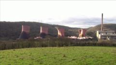 A former power station's cooling towers have been demolished in a series of controlled explosions.