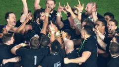 New Zealand huddle round the Webb Ellis Cup