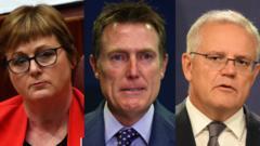 (L-R) Defence minister Linda Reynold, Attorney General Christian Porter and Prime Minister Scott Morrison