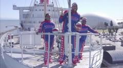 Basketball players on a ship