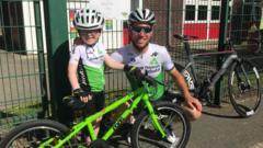 Boy standing next to Mark Cavendish
