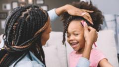 mum-styling-daughter's hair.