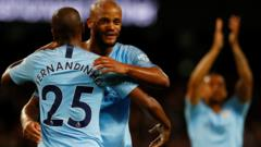 Fernandinho and Kompany hug