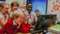 teacher-with-kids-laughing-at-computer-screen.