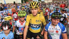 Tour de France winner Chris Froome with young cyclists before a race in France