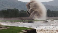A tidal wave hits a bank along the Qiantang River in Haining, China